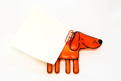Figurine toy dog. With a piece of writing Stock Photography