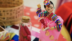 Figurine is a traditional Korean doll. To the celebration of the birth of the child stock video footage