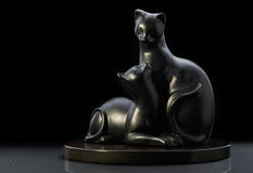 Figurine two black cats on black background. Ceramic figurine two black cats on black background stock photo