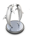 Figurine of two dolphins  on a white background. 3d. Royalty Free Stock Photos
