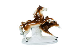 Figurine - two running horses. Figurine – two brown running horses, side view, isolated royalty free stock image