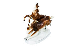 Figurine - two running horses. Figurine – two brown running horses, top view, isolated stock photography