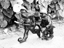 2 figurines пожарных карлика в Wroclaw Стоковые Изображения RF