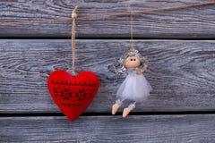 Figurines сердца и ангела Стоковые Фотографии RF