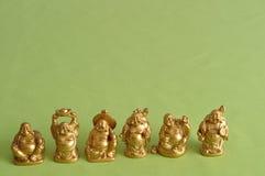 Figurines смеяться над и жизнерадостное золотое Buddhas стоковые изображения rf