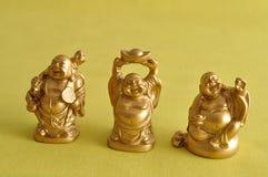 Figurines смеяться над и жизнерадостное золотое Buddhas стоковое фото rf