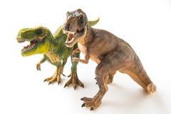 2 figurines тиранозавра Стоковые Фотографии RF