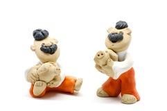 2 figurines людей Стоковая Фотография