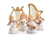 Figurines angels isolated. Figurines angels isolated on white Royalty Free Stock Photo