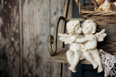 Figurines angels sitting on a bench Stock Photography