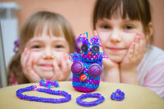 Figurines and bracelets out of loom bands Royalty Free Stock Photography