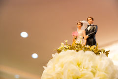 Figurines of the bride and groom on a wedding cake. Sign of love anniversary. symbol of couple life. wedding ceremony concept stock photos