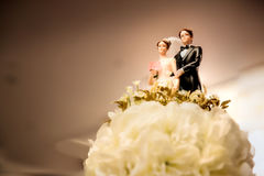 Figurines of the bride and groom on a wedding cake. Sign of love anniversary. symbol of couple life. wedding ceremony concept stock images