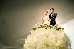 Figurines of the bride and groom on a wedding cake. Sign of love anniversary. symbol of couple life. wedding ceremony concept Royalty Free Stock Photography