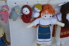 Figurines and crossed dolls. Stock Photo