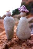 Figurines d'un couple en pierre Images stock
