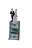 Figurines de couples de mariage sur le billet de banque de dollar US Photos libres de droits