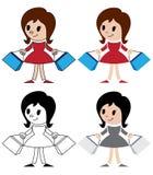 Figurines des femmes avec des paquets Photographie stock libre de droits