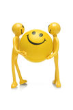 Figurines do smiley que prendem a esfera do smiley Imagens de Stock Royalty Free