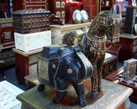 Figurines of an elephant and a horse in a street Indian store royalty free stock photography