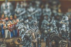 Figurines of knights. Small metal figurines of knights Royalty Free Stock Photography