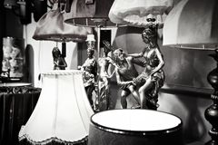 Figurines and lamps in antique store Stock Image