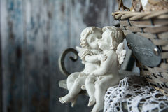 Figurines love angels sitting on a bench Royalty Free Stock Image