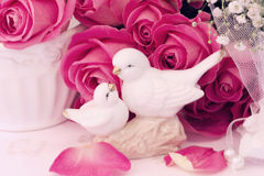 Figurines of lovers pair of wedding doves Valentine love. Tenderness vintage retro selective soft focus stock photography