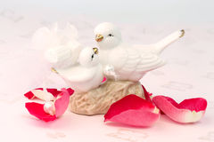 Figurines of lovers pair of wedding doves Valentine love. Tenderness vintage retro selective soft focus royalty free stock photos