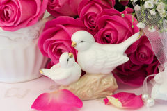 Figurines of lovers pair of wedding doves Valentine love. Tenderness vintage retro selective soft focus royalty free stock image