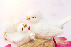 Figurines of lovers pair of wedding doves Valentine love tenderness vintage retro selective soft focus Royalty Free Stock Photos