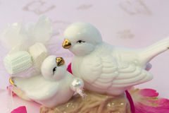 Figurines of lovers pair of wedding doves Valentine love tenderness vintage retro selective soft focus Stock Photos