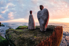 Figurines of man and woman. Of the stones at the sea Royalty Free Stock Image