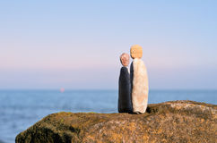 Figurines of man and woman. Of the stones at the sea Stock Photos