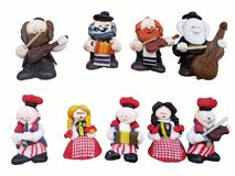 Figurines of musicians in a national jewish and polish clothes. Multicolored figurines of toys made of plasticine. Ensemble quinte. T with traditional stock photos