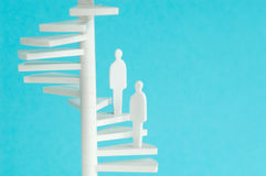 Figurines on spiral stair Royalty Free Stock Photo