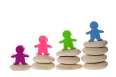 Figurines on stack of pebbles Stock Photo