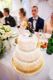 Figurines on top of cake Stock Images