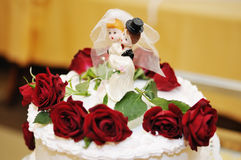 Figurines on top of wedding cake Stock Image