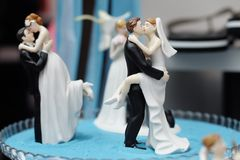 Figurines on top of wedding cake. Few original figurines on top of wedding cake Royalty Free Stock Photography