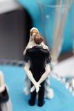 Figurines on top of wedding cake Stock Image