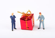Figurines of two businessmans with Christmas gift Royalty Free Stock Image