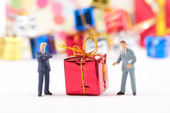 Figurines of two businessmans with Christmas gift Stock Images