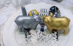 Figurines of two piggys on the holiday table stock photos