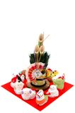 Figurines of the zodiac and New Year's pine. Royalty Free Stock Photos