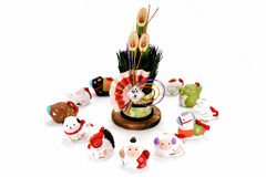 Figurines of the zodiac and New Year's pine. Figurines of 12 including the year of the Monkey royalty free stock photography