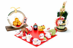 Figurines of the zodiac and New Year's pine and Three golden str Royalty Free Stock Photos