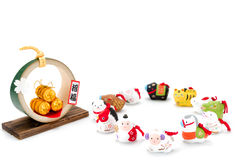 Figurines of the zodiac and Three golden straw rice bags. Figurines of 12 including the year of the Sheep royalty free stock images