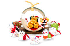 Figurines of the zodiac and Three golden straw rice bags. Stock Photos