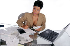 Figuring out her taxes Royalty Free Stock Image